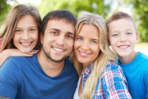 A family giving showing a big bright smile.