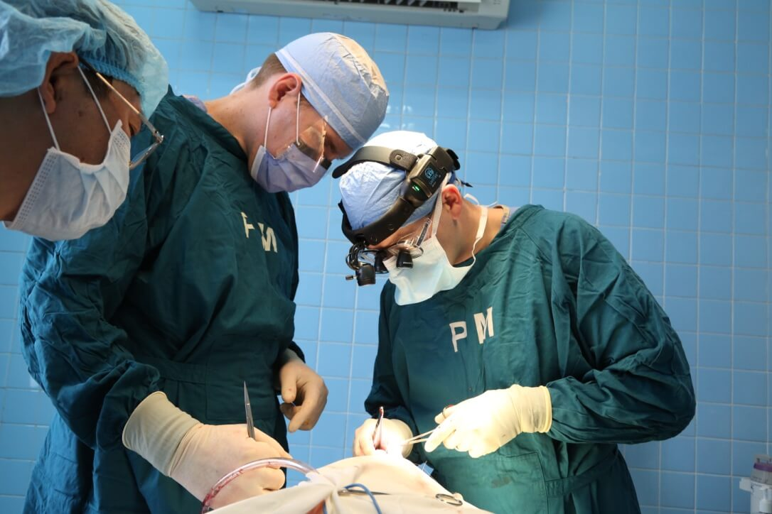 Dentists performing an operation during their trip to Vietnam.